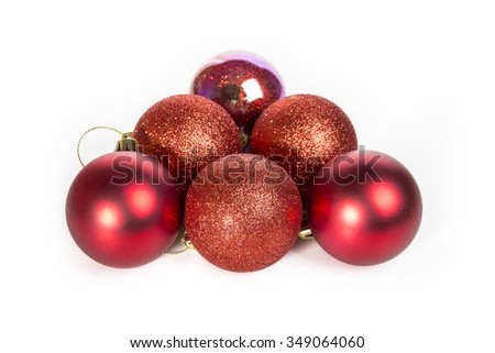 red Christmas balls on a white table