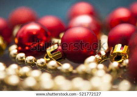 Red Christmas balls over blue holiday background. Magic holiday lights. Merry Christmas and a Happy New Year