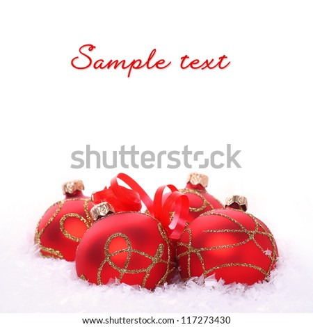 Red christmas balls with snow isolated on white background - stock photo