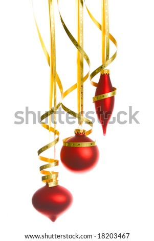 Red christmas balls with yellow stripes over white