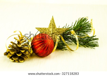 red christmas bauble,golden star and pine cone decoration