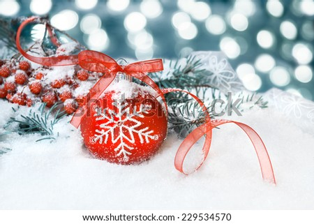 Red Christmas bauble on a neutral winter background - stock photo