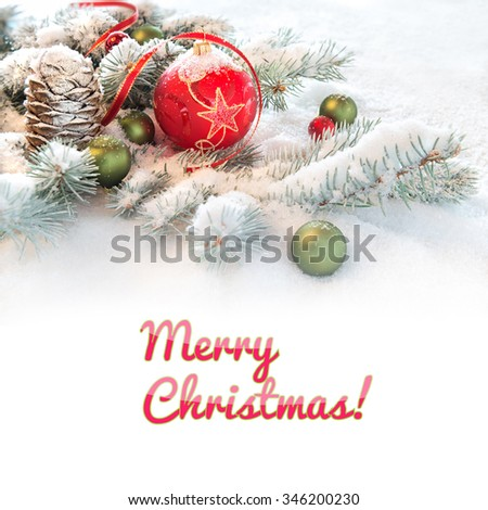 """Red Christmas bauble on decorated fir twigs in snow, caption """"Merry Christmas"""" on flat white background. You can exchange it for your text if you wish. - stock photo"""