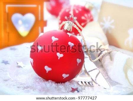 Red Christmas Bauble with a decorative heart-shaped christmas lantern and a festive table setting
