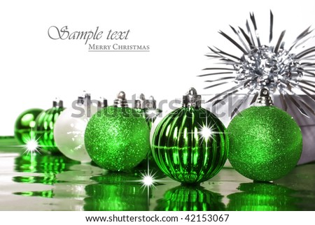 Red christmas bauble with stars on a white background with space for text - stock photo