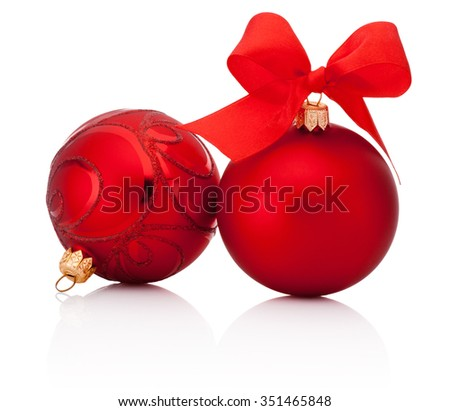 Red christmas baubles with ribbon bow isolated on white background - stock photo