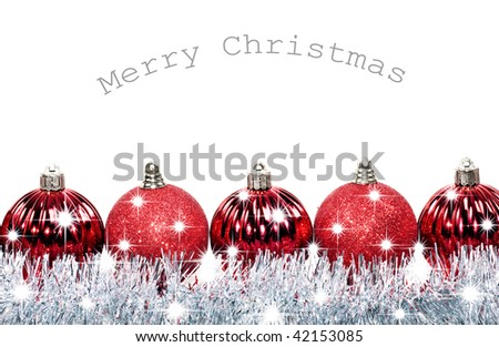 Red christmas baubles with stars on a white background with space for text - stock photo