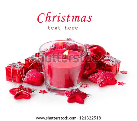 red christmas candle  with decorations isolated on white - stock photo
