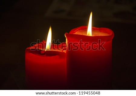 Red Christmas candles on a black background.