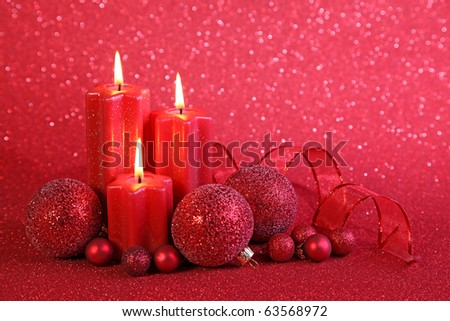 Red christmas candles on red background