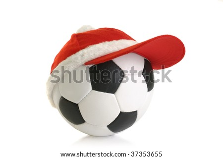 red Christmas cap on soccer ball isolation - stock photo