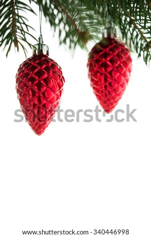 Red christmas cones on the xmas tree on white background isolated. Merry christmas card. Winter holidays. Xmas theme. Happy New Year. - stock photo