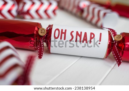 "red christmas cracker with fun phrase ""oh snap!"" - stock photo"