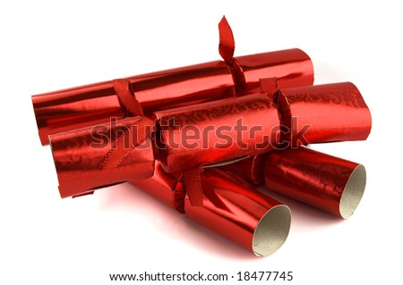Red Christmas crackers isolated on a white background