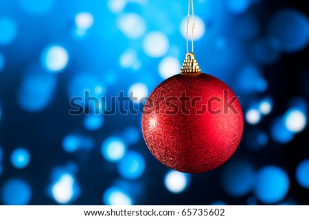 red Christmas decoration against blue defocused background - stock photo