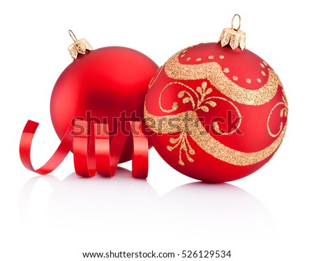 Red christmas decoration baubles and curling paper isolated on white background