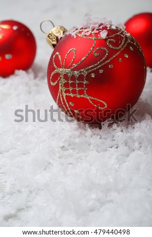 Red christmas decorations on artificial snow, xmas