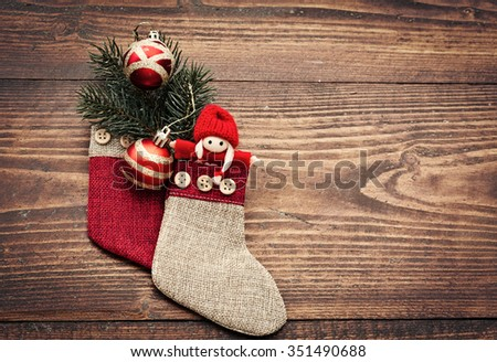 Red Christmas decorations on rustic wooden background