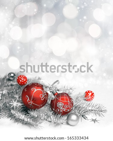 Red Christmas decorations with silver ornament on neutral winter background, text space. Shallow DOF, focus on the knot - stock photo