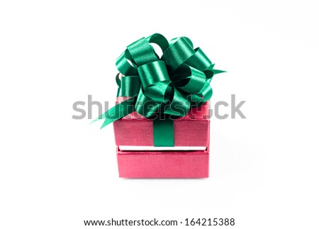 Red Christmas gift box tied with lime green shimmering ribbon