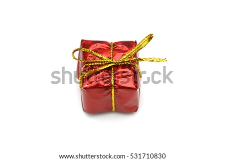 Red christmas gift box with a gold ribbon bow, isolated on white background