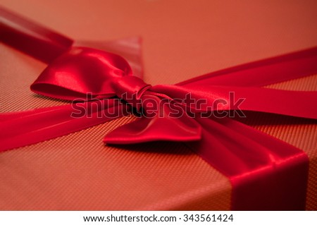 Red Christmas Gift box with ribbon and bow - stock photo