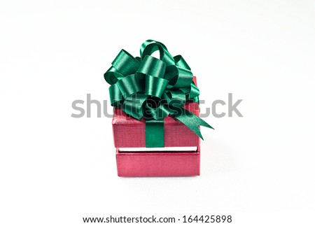 Red Christmas giftbox tied with lime green shimmering ribbon