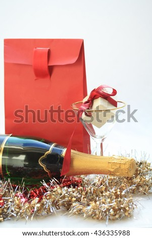 Red christmas gifts and a bottle of champagne - stock photo
