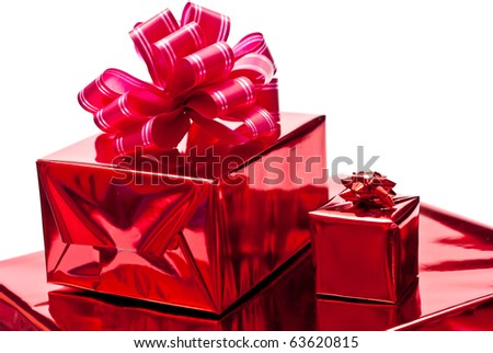 Red christmas gifts boxes with bow. Isolated on white