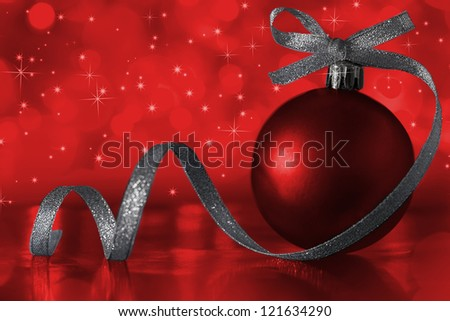 Red christmas ornament with tape over illuminates - stock photo