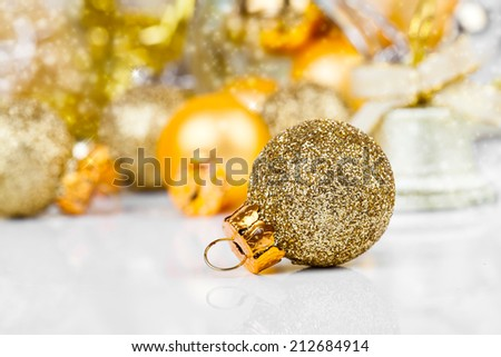 Red christmas ornaments with golden christmas bauble - stock photo