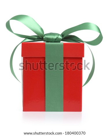 Red Christmas present with green bow on white background  - stock photo