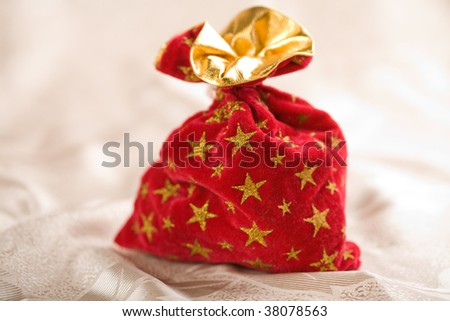 red christmas sack full of gifts - stock photo
