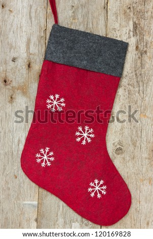 Red christmas sock hung on the old wooden wall - stock photo