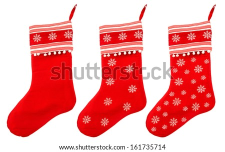 red christmas sock with snowflakes for Santa gifts on white background. winter holidays symbol - stock photo