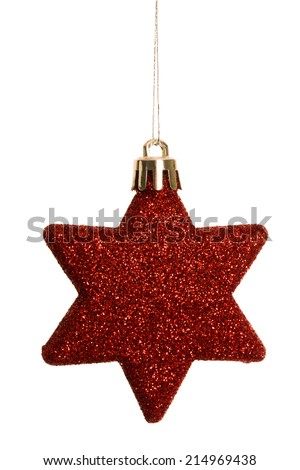 Red christmas star decoration hanging on white background - stock photo