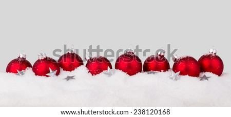 red christmas tree balls with card in snow/christmas/snow - stock photo