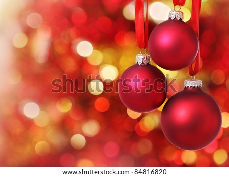Red Christmas tree decorations on lights background - stock photo