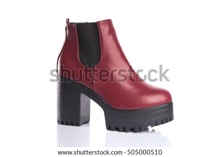 Red chunky heel boot, isolated on white background