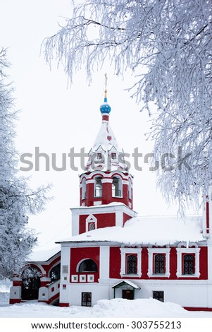 Red church in winter in Uglich