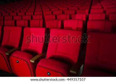 Red cinema or theater seats in dramatic light