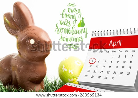 red circle against chocolate bunny rabbit and three easter eggs - stock photo
