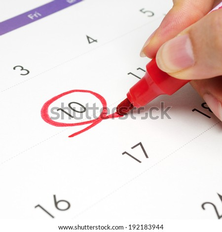 Red circle. Mark on the calendar at 10.  - stock photo