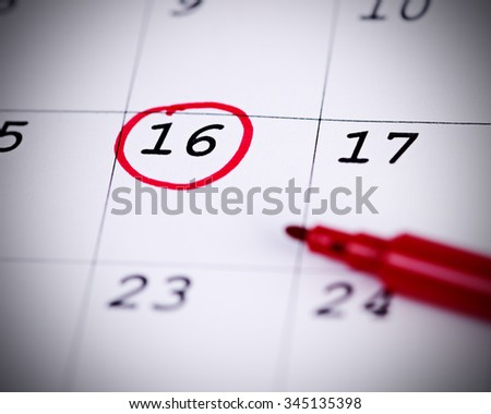 Red circle. Mark on the calendar at 16. - stock photo