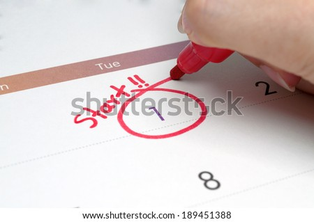 Red circle. Mark on the calendar at 1 and the words start. - stock photo