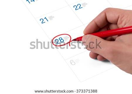 Red circle. Mark on the calendar at February 28, 2016 - stock photo