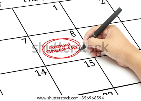 Red circle.Mark on the calendar with words Annual Check-up written on a calendar to remind you an important appointment