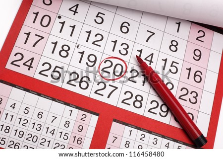 Red circle marked on a calendar concept for an important day or reminder - stock photo