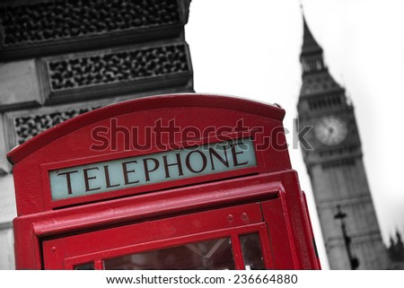 Red classic phone booth box with London landmark Big Ben in background - stock photo