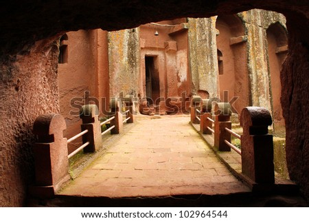 Red clay and stone Ethiopian rock hewn church - stock photo